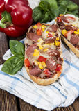 Portion of Salami Pizza Baguette Royalty Free Stock Images