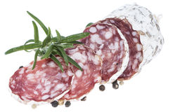Portion of Salami on white Stock Photography