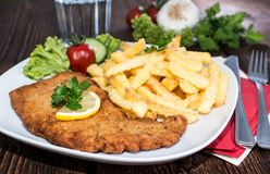 Portion of Schnitzel with Chips Stock Image