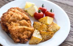 Portion of schnitzel with garnish Royalty Free Stock Image