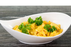 Portion of scrambled eggs in a bowl Stock Photos