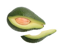 Portion of single green avocado. Royalty Free Stock Image