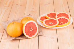 Portion of sliced grapefruit on plate. Stock Photography