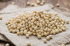 Portion of Soy Beans. Soy Beans (detailed close-up shot) on rustic wooden background Royalty Free Stock Images