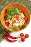 Portion of spaghetti bolognese with basil leaves and tomatoes Royalty Free Stock Images