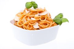 Portion of spaghetti with pesto rosso. Isolated on white background Stock Photography