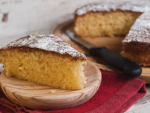 Portion of a sponge cake on a wooden plate Royalty Free Stock Photo