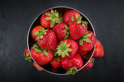 Portion of Strawberries on a slate slab Royalty Free Stock Image