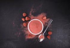 Portion of Strawberry powder on a slate slab Stock Image