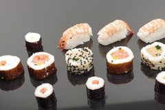 Appetizing  portion sushi. Portion sushi on black plate Royalty Free Stock Photography