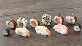 Appetizing  portion sushi. Portion sushi and wooden hopsticks on plate Stock Image