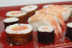 Appetizing  portion sushi. Portion sushi and wooden hopsticks on plate Royalty Free Stock Images