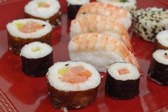 Appetizing  portion sushi. Portion sushi and wooden hopsticks on plate Stock Photo
