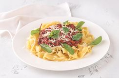 Portion of tagliatelle with bolognese sauce. On the table stock image