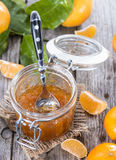 Portion of Tangerine Jam. With some fresh fruits Royalty Free Stock Images