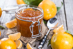 Portion of Tangerine Jam. With some fresh fruits Royalty Free Stock Image