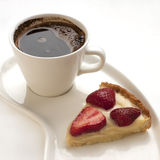 Portion tart with coffee cup Stock Photos