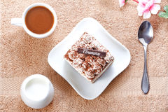 Portion of tiramisu dessert and a cup of coffee Royalty Free Stock Image