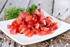 Portion of Tomatoe Salad Stock Photos