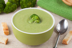 Portion of vegan green broccoli cream soup with Stock Image