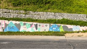 Portion of whimsical mural by sourgrapes along Sylvan Avenue, Dallas, Texas. Pictured is part of a long whimsical mural along Sylvan Avenue in Dallas, Texas.  It Royalty Free Stock Photography