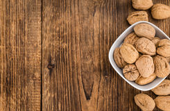 Portion of Whole Walnuts on wooden background selective focus Royalty Free Stock Photos