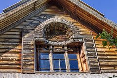 A portion of a window. Woodcarving. Russian village. Old wooden houses - monument of ancient wooden architecture Russia. Architectural-Ethnographic Museum royalty free stock photos