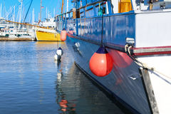 Portion of yacht tied to dock Royalty Free Stock Photography
