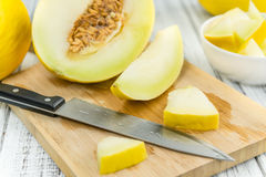 Portion of Yellow Honeydew Melon on wooden background selective Royalty Free Stock Image