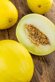 Portion of Yellow Honeydew Melon on wooden background selective Royalty Free Stock Images
