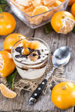 Portion of Yogurt with Tangerines and Chocolate Stock Image