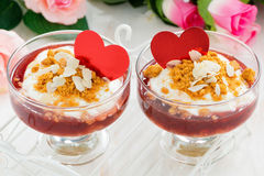 Portioned dessert with berry jam and cream for Valentine's Day Stock Image