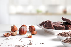 Portions and chocolate chips on containers with hazelnuts in kit Stock Photo