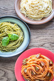Portions of colorful spaghetti with ingredients royalty free stock photo
