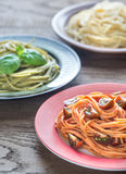 Portions of colorful spaghetti with ingredients Stock Image