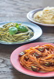 Portions of colorful spaghetti with ingredients Royalty Free Stock Photography