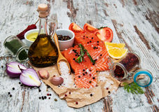 Portions of fresh salmon fillet. With aromatic herbs, spices and vegetables Stock Image
