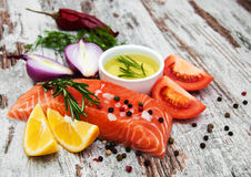 Portions of fresh salmon fillet. With aromatic herbs, spices and vegetables Royalty Free Stock Photo