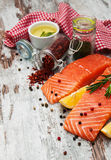 Portions of fresh salmon fillet. With aromatic herbs, spices and vegetables Royalty Free Stock Images
