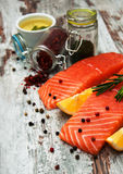Portions of fresh salmon fillet. With aromatic herbs, spices and vegetables Stock Photos
