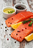Portions of fresh salmon fillet. With aromatic herbs, spices and vegetables Royalty Free Stock Photography
