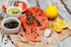 Portions of fresh salmon fillet. With aromatic herbs, spices and vegetables Stock Photo