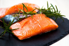 Portions of Fresh Salmon Fillets with Aromatic Herbs and Spices. Portions of Fresh Raw Salmon Fillets with Aromatic Herbs and Spices , Shallow DOF, Selective Royalty Free Stock Photography