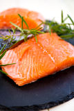 Portions of Fresh Salmon Fillets with Aromatic Herbs and Spices. Portions of Fresh Raw Salmon Fillets with Aromatic Herbs and Spices , Shallow DOF, Selective Royalty Free Stock Image