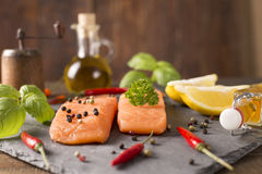 Portions of fresh salmon fillets Royalty Free Stock Photos