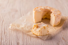 Portions of golden camembert cheese on white board Royalty Free Stock Photos
