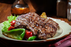 Portions of grilled beef steak with grilled potatoes and paprika Stock Photo