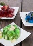 Portions of mixed Jello stock photos