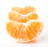 Portions of orange on white Royalty Free Stock Photo