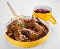 Portions of roasted wild rabbit with orange. Portions of roasted wild rabbit flavored with orange zest, fresh herbs and mushrooms served in a rich gravy in a stock photography